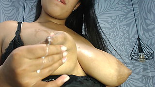 Native American girl sucking milk from her big pointy boobs