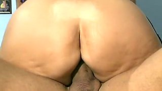 Mature brunette voracious whore on the couch having passionate sex