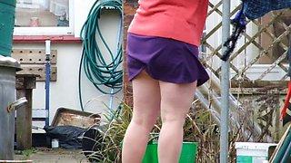 wife hanging washing - pantieless
