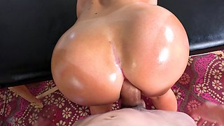 A chick with big tits is riding a hard dick with her hot ass