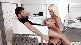 Busty blonde is using her boobs to make him hard