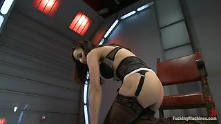 Sexy chick in stockings gets her pussy toyed by a machine
