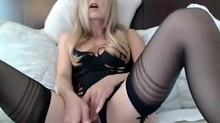 Provoking blonde puts on her sexy black lingerie and please