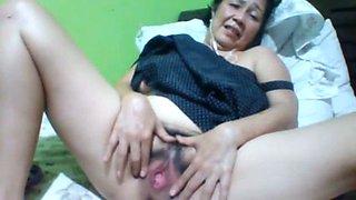Filipina fatty with dark hair and saggy huge boobs masturbates herself