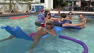 slutty bitches chillin' in the pool