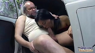 old and young girl service in a car garaje
