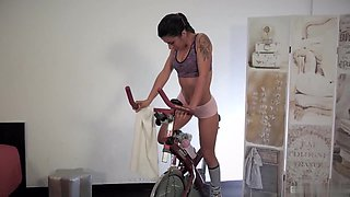 Brunette teen Lilly Foxx likes to ride the bicycle to keep her cute Latina figure in shape