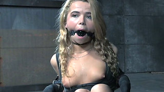 Tied up blonde is sitting on the floor while master plays with her cunt
