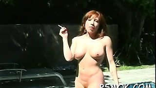 Older slut blows a lad while smoking a cigarette