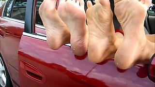 Two sensual amateur girls expose their sexy feet in public