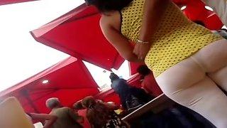Huge fanny MILF followed in street candid voyeur video