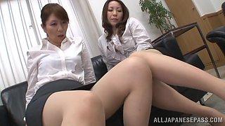 Hot Japanese MILFs Giving A Nasty Foot Job And Handjob