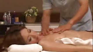Tan Japan milf oiled up and fingered on massage bed