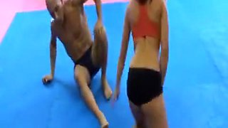 Sporty girl mixed wrestling