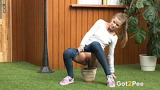 Quite sporty and flexible light haired chick tries to pee in the bowl