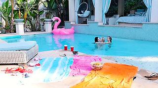 Cute skinny teens enjoyed in a lesbian sex near a pool