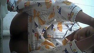 Asian peeing in pajama