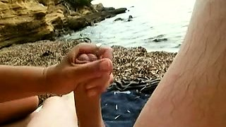 Busty amateur wife delivers a great handjob on the beach