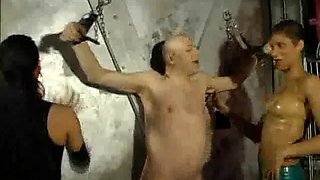 two dominatrix punishes a slave solo