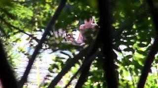 Beach voyeur films a lovely blonde getting banged doggystyle