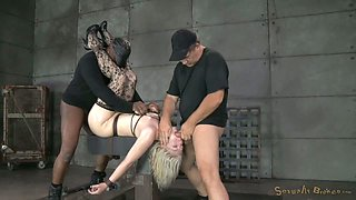 She lies on table with her hands and legs tied and receives dick in her pussy