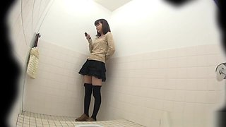 This glorious Asian babe was spied on by an voyeur while taking a piss in public toilet