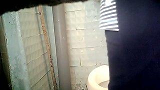 Lovely pale skin stranger chick filmed in the toilet room urinating