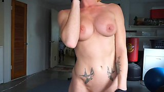 Ginger busty milf working naked in the gym