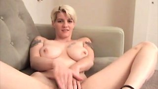 Sexy busty blonde massaging her hairy pussy and swollen clit