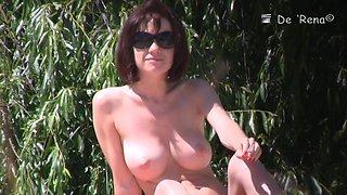 Hot nudist woman captured by a hidden beach camera