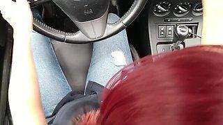 Redhead masturbates in her car. Feeling the urge in a public parking lot