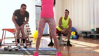 Slim fit brunette gangbangs at gym