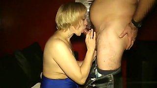 Cum swallowing in a porn cinema