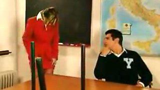 Teacher takes two cocks in classroom