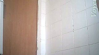 Fine curvaceous blonde lady in white dress filmed in the toilet room
