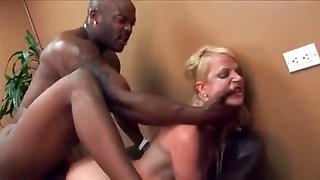 Hot ass blonde whore in fishnet stockings gets black cock