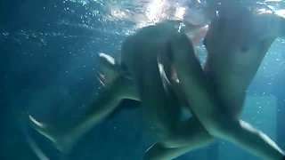 Two delectable and juicy Russian teens undressing in the pool