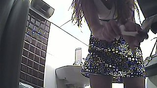 Blonde curvy stranger girl pulls up her skirt and pisses in the public toilet room