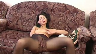 Naturally horny brunette Valeria experiments a bit in her pantyhose