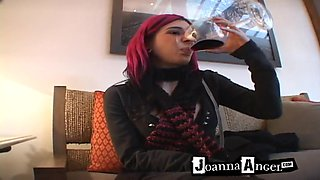 Kinky red-haired senorita drinks a large glass of wine
