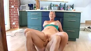 Granny in seductive lingerie fucked in the kitchen hard