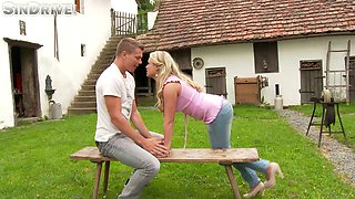 Elegant girls engage in a sensual lesbian act outdoors in a reality shoot