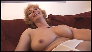 Attractive mature milf in stockings strips and shows off