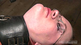 Spoiled bimbo in glasses gets her pussy fisted during her BDSM session