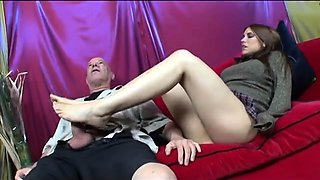 Stacked brunette milf engages in a wild foot fetish affair