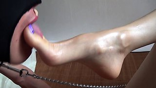 Dominant Korean goddess has a masked slave licking her toes