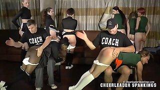 Group of cheerleaders spanked