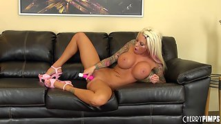 Blonde with a humongous pair of tits shows how she masturbates