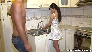 Teen with a shaved pussy enjoying a hardcore missionary style fuck in her kitchen