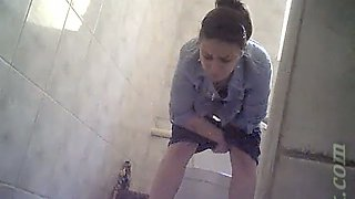 Cute brunette white girl in tight short pisses in the toilet